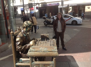 A very-believable street performer posing as a statue.